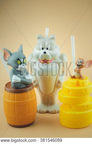 Bangkok, Thailand - August 19, 2020 : Set Of Plastic Drink Cup Tom And Jerry To Promote The Movie Of