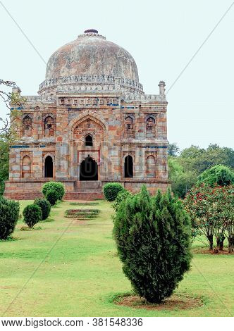 Ancient Mausoleum Of The Mughal Period Sheesh Gumbad, 16 Century, In The Lodi Garden Park In New Del