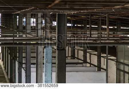 The Structure Inside The Warehouse With Light Pole. Old Structure In Old Building Indoor. Selective
