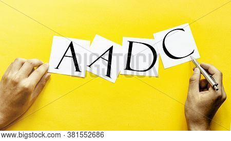 White Paper With Text Aadc Aromatic L-amino Acid Decarboxylase Deficiency On A Yellow Background Wit