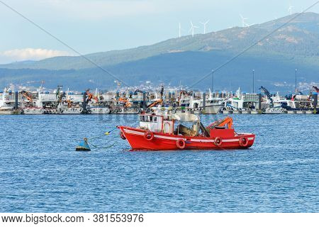Red Wooden Fishing Boat Moored In The Fishing Port