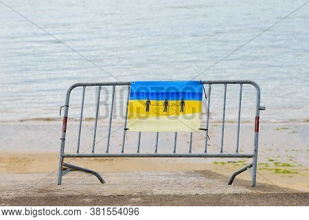 Metal Barrier With Poster Keep Distance Of 2 Meters Installed On The Beach