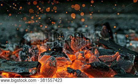 Barbecue Grill Pit With Glowing And Flaming Hot Charcoal Briquettes, Close-Up