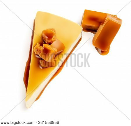 Caramel Cheesecake Pie With Caramel Sauce  And Candy Isolated On A White Background Close Up. Top Vi