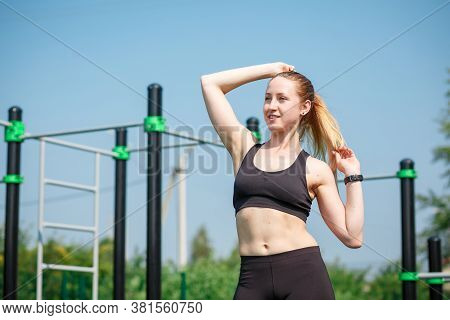 Young Happy Fitness Caucasian Woman With Sporty Body At On Street Sports Field. Beautiful Fit Girl.