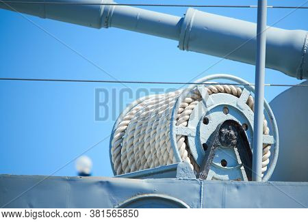 Cable Reel With A White Rope On The Deck Of The Ship Against Blue Sky