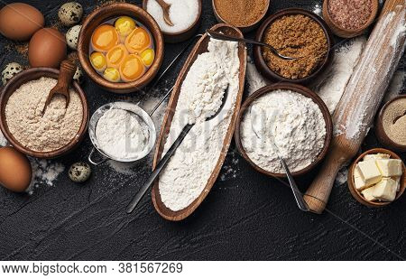 Baking Ingredients On Black Background, Top View