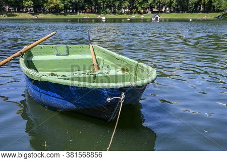 A Boat With Oars Floats On The Pond In Sunny Weather. Moscow, Patriarch's Ponds, Russia.