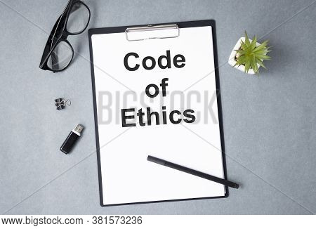 Code Of Conduct Text On Notebook. Concept Of Ethical Integrity, Value And Ethics.