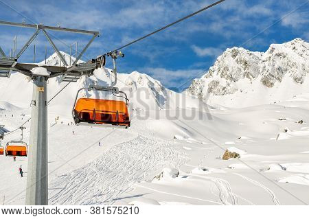 Ski Lift Ropeway On Hilghland Alpine Mountain Winter Resort On Bright Sunny Day. Ski Chairlift Cable