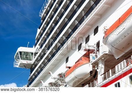 Cozumel,Mexico-July 5,2017: Side view of Cruise ship ,there are 314 cruise ships operating worldwide, with a combined capacity of 537,000 passengers