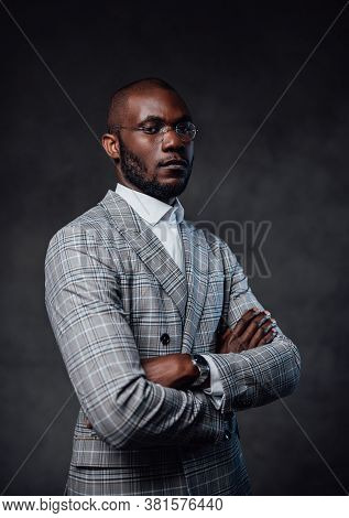 Foggy Gray Background. Black Serious Business Person. A Successful Professional Entrepreneur With Gr