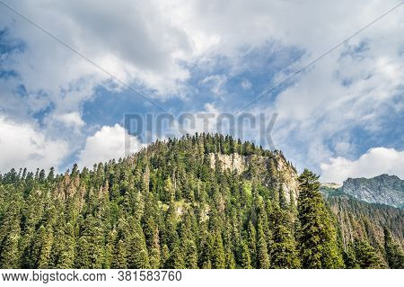 Peaks Of Magnificent Rocks Located Against Bright Cloudy Sky On Sunny Day In Nature
