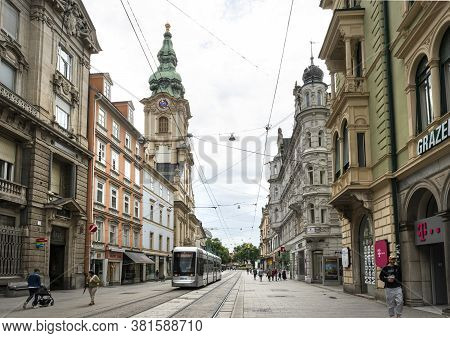 Graz, Austria. August 2020.  Some Young People Meet On Herrengasse Street In The City Center