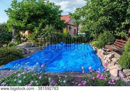 Rolled Out Blue Hdpe Plastic Sheet On The Ground To Set Up A Fish Pond