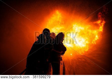 Operation Emergency Firefighter Spraying High Pressure Water To Fire, Professional Team Fireman Trai