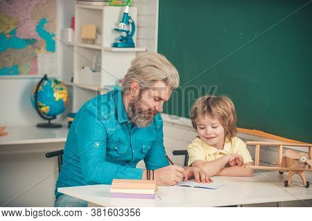 Teacher And Pupil In Classroom. Child Home Studying And Home Education. Pupils Education. Afterschoo