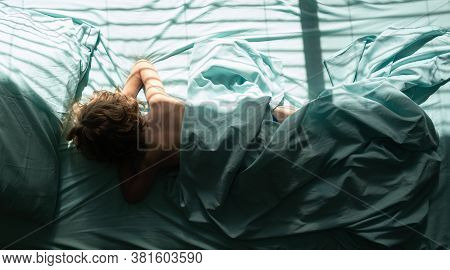 Kids Little Boy Is Laying Down And Sleeps On Pillow. Top View Of Child Sleeping Cozily On A Bed In B