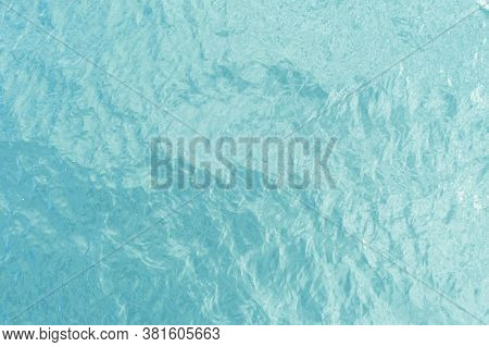 Aerial View Of A Crystal Clear Sea Turquoise Water Texture. View From Above Natural Blue Background.