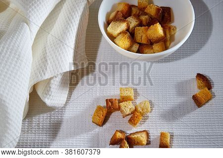 Square Toasted Pieces Of Homemade Delicious Rusk, Hardtack, Dryasdust, Zwieback In A Plate On A Whit