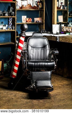 Stylish Vintage Barber Chair. Logo Of The Barbershop, Symbol. Barber Shop Pole. Hairstylist In Barbe