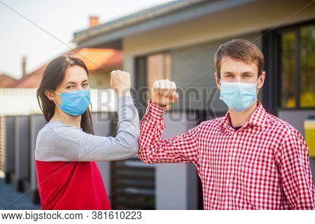 Elbow Bump. Coronavirus, Illness, Quarantine, Medical Mask, Covid19. Couple Greeting With Elbows. El