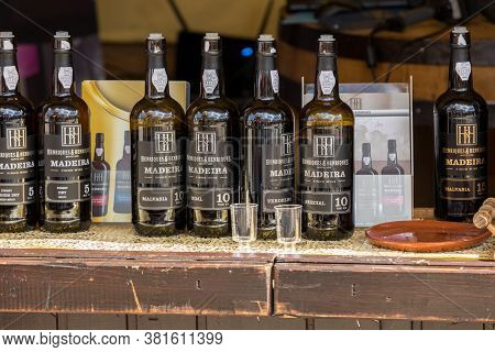 Funchal, Madeira, Portugal - April 19, 2018: Bottles Of Madeira Wine At A Street Market Stall In Fun