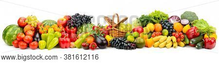 Wide panoramic composition of ripe, juicy fruits, berries and vegetables isolated on white background.