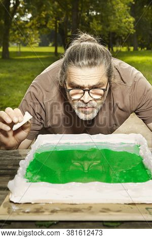 Casting Of Possible Emerald Tablet Visualisation With Epoxy Resin To Prepared Form (no Real Meaning)