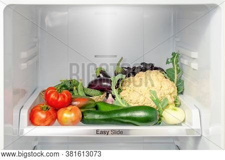 Shelf In The Refrigerator With Vegetables. Open Refrigerator Full Of Vegetables. Healthy Lifestyle C
