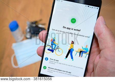 Bennekom, Netherlands, Aug, 20, 2020:smartphone With Dutch Corona Tracking App Named:coronamelder. F