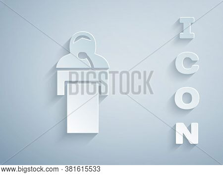 Paper Cut Gives Lecture Icon Isolated On Grey Background. Stand Near Podium. Speak Into Microphone.