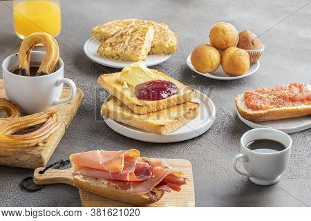 Different Spanish Breakfast, Tortilla, Bruschetta With Jamon (cured Ham) And Tomatoes, Churros With