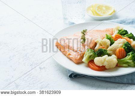 Steam Salmon And Vegetables, Paleo, Keto, Fodmap, Dash Diet. Mediterranean Food With Fish