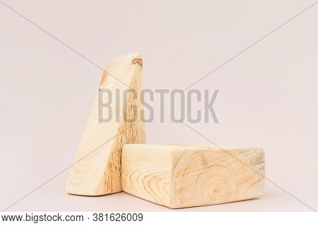 Wooden Textured Square And Triangular Podiums On A Light Background. Background For Product Photogra