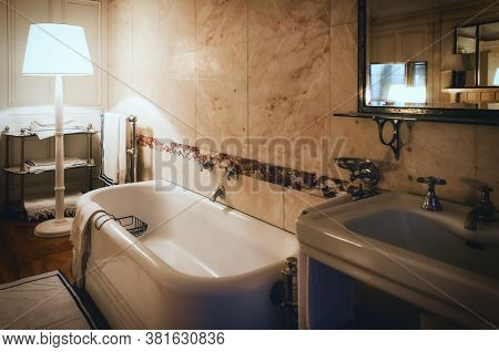 Very Old And Rich Bathroom From The Beginning Of The Xx Century, With Mirror, Faucet, Bathtub And Ba