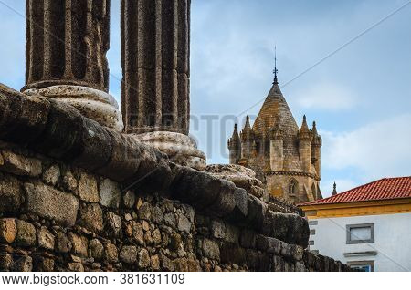 The Roman Temple Of Diana In Evora, Main Example Of Roman Architecture In Portugal, With The Cathedr