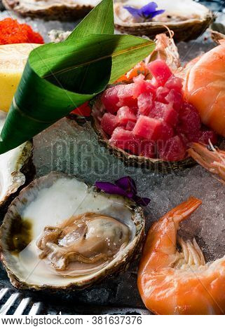 Seafood Plate Set On Ice. Close Up Detail On Small Seafood Platter With Oyster. Seafood Plate Oyster