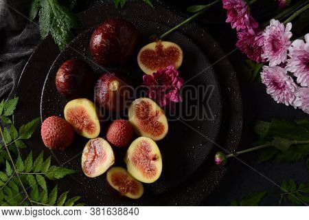 Raw Fresh Fig Fruit Slices With Organic Lychee Fruit. Fresh Lychee And Peeled Showing The Red Skin A