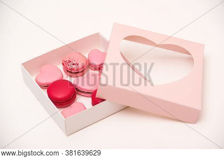 Macaroons Cookies In Box On White Table. French Cookies In Gift Box. Sweet Macarons In Gift Box. Tra