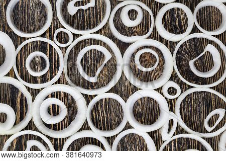 Ripe Onions Sliced On A Board, Used For Cooking Food And Sauces, Close-up Of Food Of Natural Origin