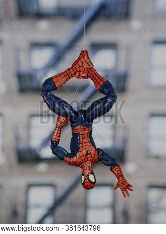 AUGUST 19 2020: superhero Spiderman hanging upside down from a web - Hasbro Legends action figure