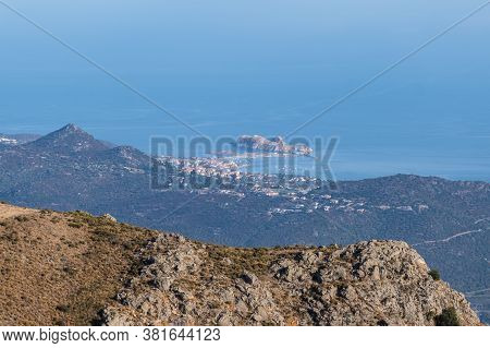 The Red Rock Of Ile Rousse In The Balagne Region Of Corsica Surrounded By The Blue Mediterranean Sea