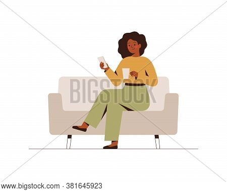 The Black Businesswoman Is Sitting On The Couch With A Mobile Phone At The Break Time. Young Dark Sk