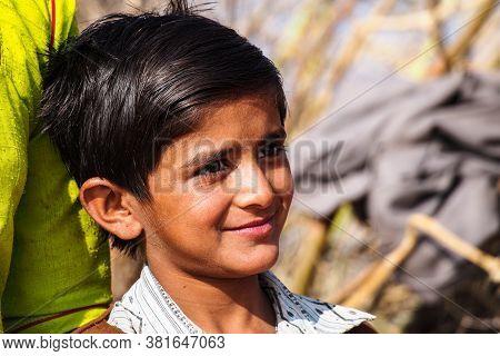 Jaisalmer, India - Dec 30, 2019: Lucky Boy Working On The Cotton Fields Of Jaisalmer, Rajasthan