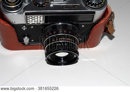 Soviet Camera On A Light Background In A Case.
