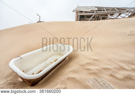 A Bathtub On A Sand Dune At Kolmanskop, An Abandoned Diamond Mining Town Near Luderitz