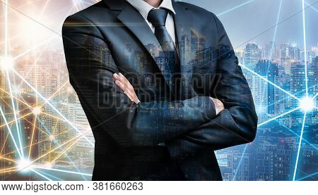 Double Exposure Of Business Man Folded Arms On City Night Background For Successful Of Investment An