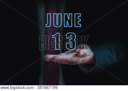 June 13th. Day 13 Of Month, Announcement Of Date Of Business Meeting Or Event. Businessman Holds The