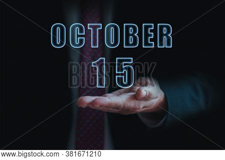 October 15th. Day 15 Of Month, Announcement Of Date Of Business Meeting Or Event. Businessman Holds